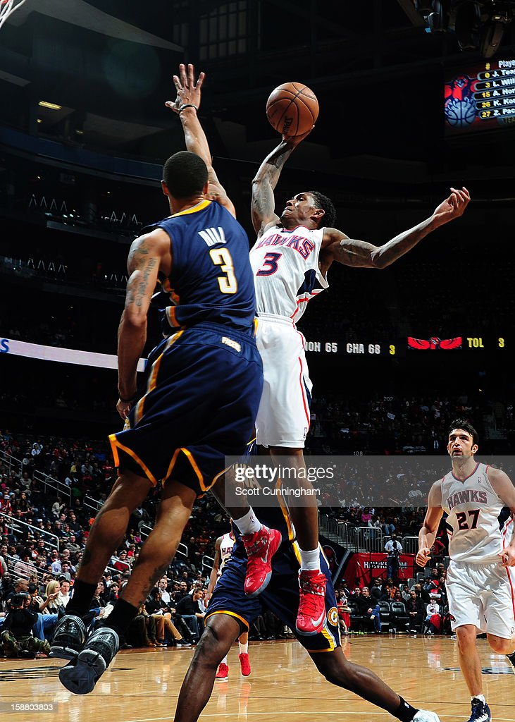 <a gi-track='captionPersonalityLinkClicked' href=/galleries/search?phrase=Louis+Williams&family=editorial&specificpeople=670315 ng-click='$event.stopPropagation()'>Louis Williams</a> #3 of the Atlanta Hawks shoots against George Hill #3 of the Indiana Pacers on December 29, 2012 at Philips Arena in Atlanta, Georgia.