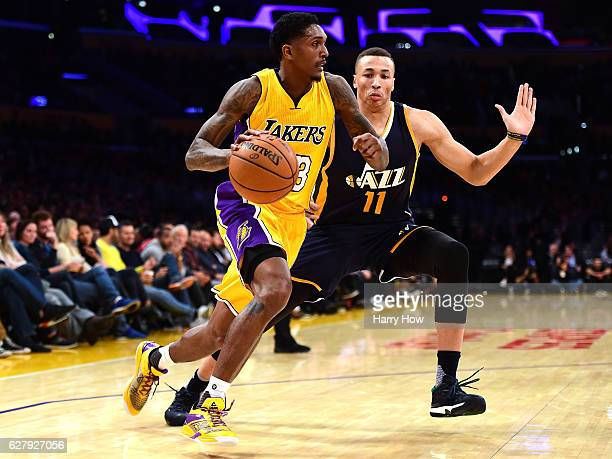 Louis Williams of the Los Angeles Lakers dribbles against Dante Exum of the Utah Jazz during the first half at Staples Center on December 5 2016 in...