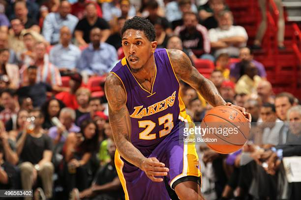 Louis Williams of the Los Angeles Lakers drives to the basket against the Miami Heat on November 10 2015 at AmericanAirlines Arena in Miami Florida...