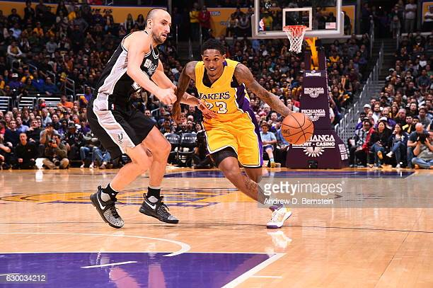 Louis Williams of the Los Angeles Lakers drives to the basket against the San Antonio Spurs on November 18 2016 at STAPLES Center in Los Angeles...