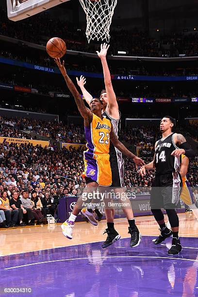 Louis Williams of the Los Angeles Lakers goes up for a lay up against the San Antonio Spurs on November 18 2016 at STAPLES Center in Los Angeles...