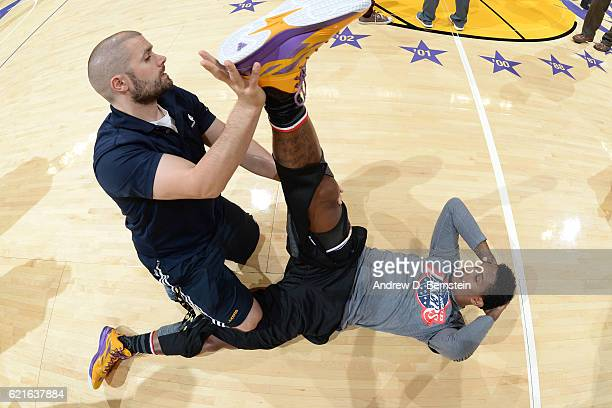 Louis Williams of the Los Angeles Lakers stretches on the court before the game against the Golden State Warriors on November 4 2016 at STAPLES...