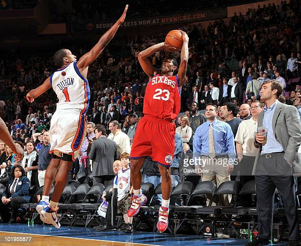 Louis Williams of the Philadelphia 76ers shoots a jump shot against Chris Duhon of the New York Knicks during the game at Madison Square Garden on...