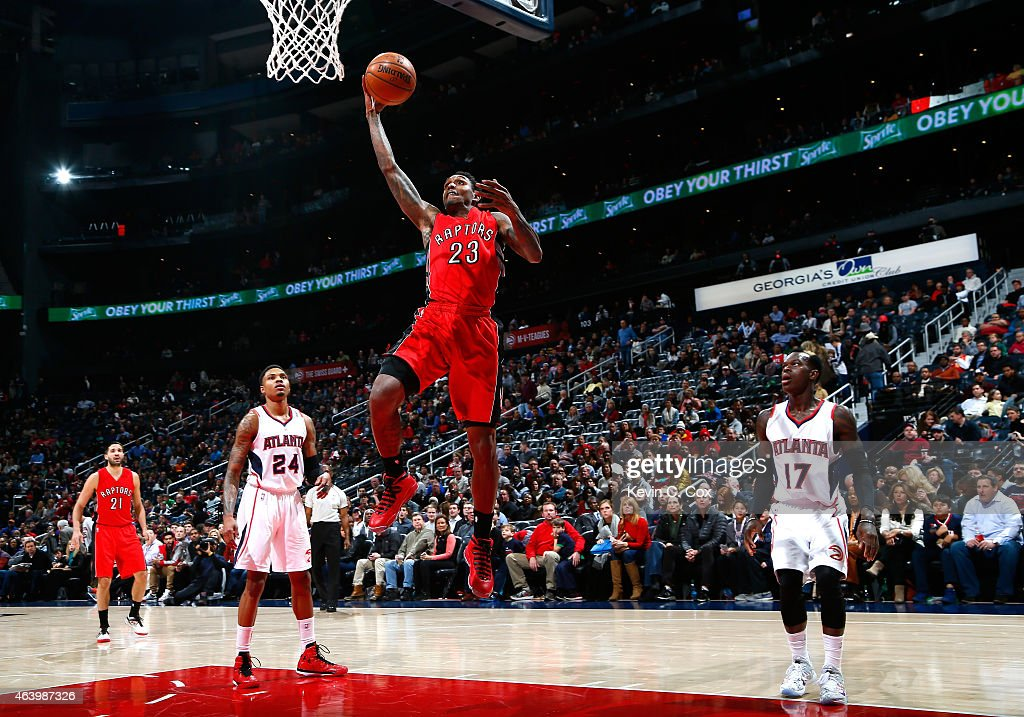 Louis Williams of the Toronto Raptors attacks the basket against Kent Bazemore and Dennis Schroder of the Atlanta Hawks at Philips Arena on February...