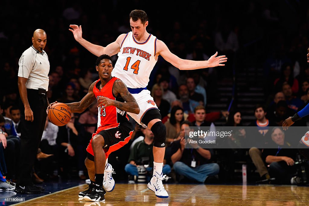 Louis Williams of the Toronto Raptors controls the ball against Jason Smith of the New York Knicks in the second half at Madison Square Garden on...