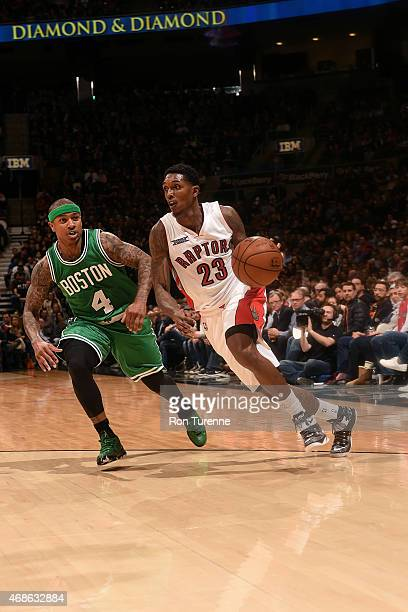 Louis Williams of the Toronto Raptors drives against Isaiah Thomas of the Boston Celtics on April 4 2015 at the Air Canada Centre in Toronto Ontario...