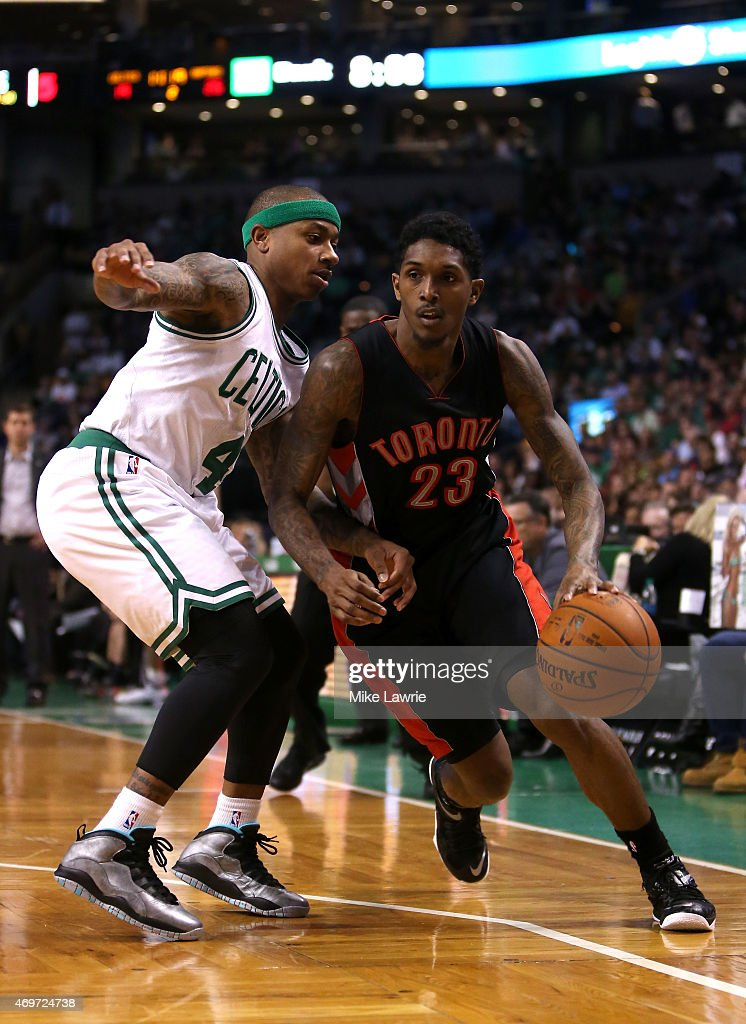 Louis Williams of the Toronto Raptors handles the ball against Isaiah Thomas of the Boston Celtics in the first half at TD Garden on April 14 2015 in...