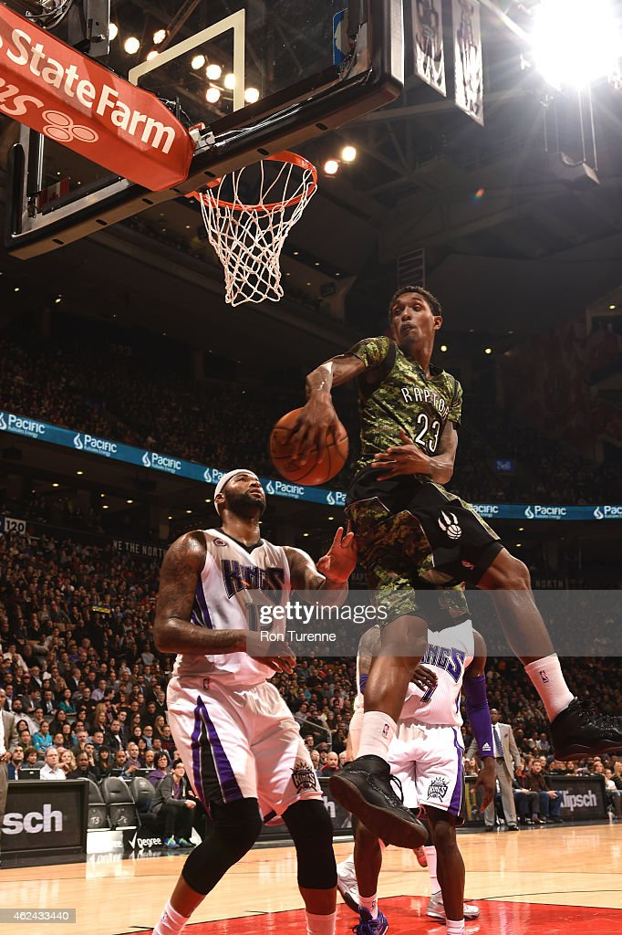 Louis Williams of the Toronto Raptors makes a pass against the Sacramento Kings on January 28 2015 at the Air Canada Centre in Toronto Ontario Canada...