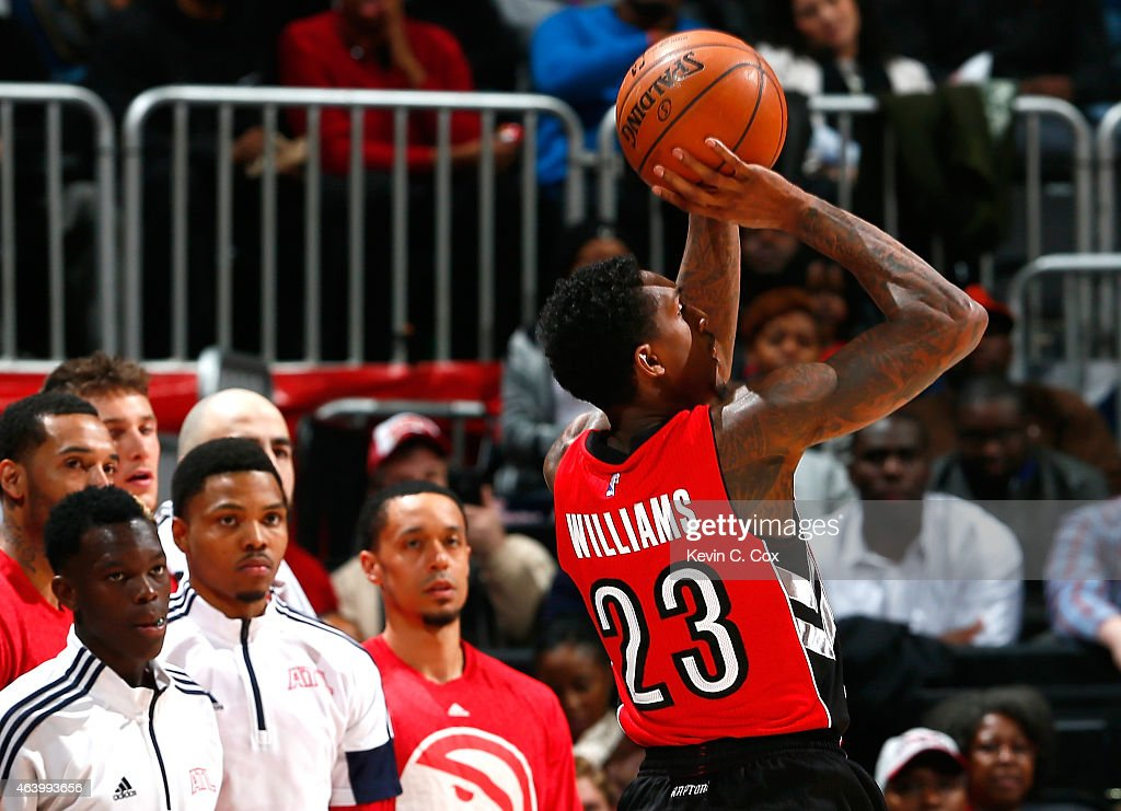 Louis Williams of the Toronto Raptors shoots a threepoint basket against the Atlanta Hawks at Philips Arena on February 20 2015 in Atlanta Georgia...