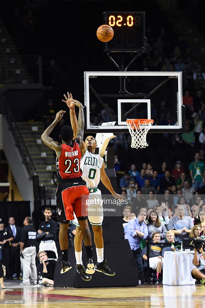Louis Williams of the Toronto Raptors shoots the game winning shot against Avery Bradley of the Boston Celtics on October 15 2014 at the Cross...