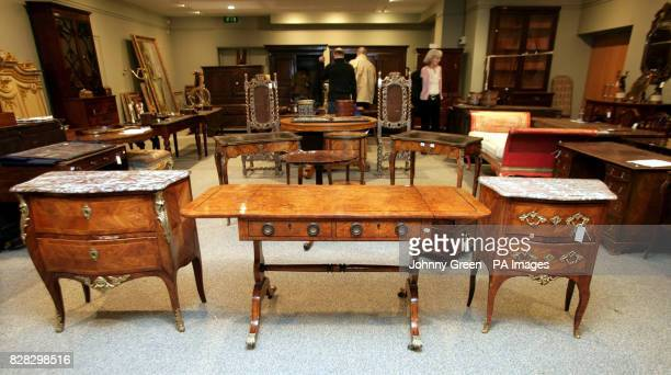 A Louis XV kingwood bombe commode a regency pollared oak and ebony strung sofa table and a Louis XV kingwood and boxwood strung serpentine commode...