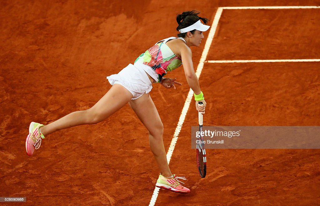 Louisa Chirico of the United States serves against Dominika Cibulkova of Slovakia in their semi final match during day seven of the Mutua Madrid Open tennis tournament at the Caja Magica on May 06, 2016 in Madrid,Spain.