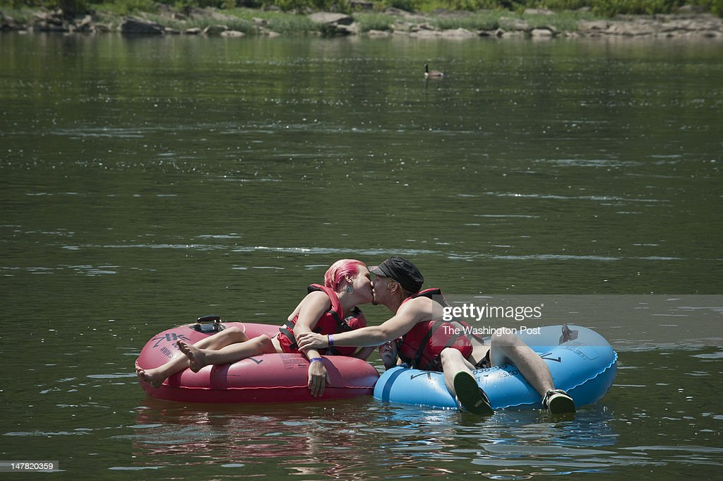 Harper's Ferry WV July 3 Louisa Dickison left and Ariel Schultz get cozy tubing on the Potomac River in Harper's Ferry West Virginia on Tuesday July...