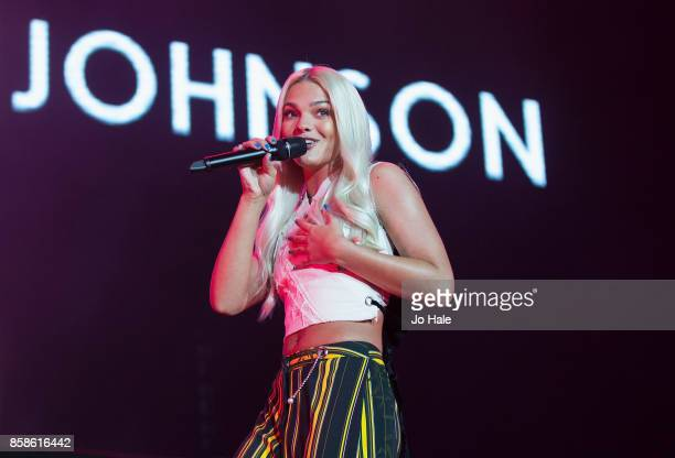 Louisa Johnson performs on stage at Girlguiding UK's Big Gig at SSE Arena on October 7 2017 in London England