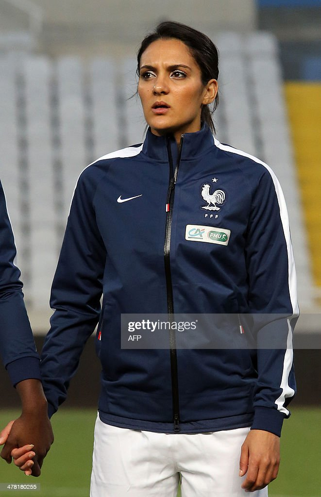 Louisa Necib a player in France's women's national football team listens to her national anthem prior to their Cyprus Women's Cup final against England at the Neo GSP stadium in Nicosia on March 12, 2014.