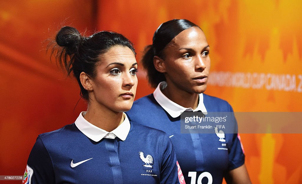 Louisa Necib and Marie Laure Delie of France wait in the players tunnel during the FIFA Womens's World Cup round of 16 match between France and Korea at Olympic Stadium on June 21, 2015 in Montreal, Canada.