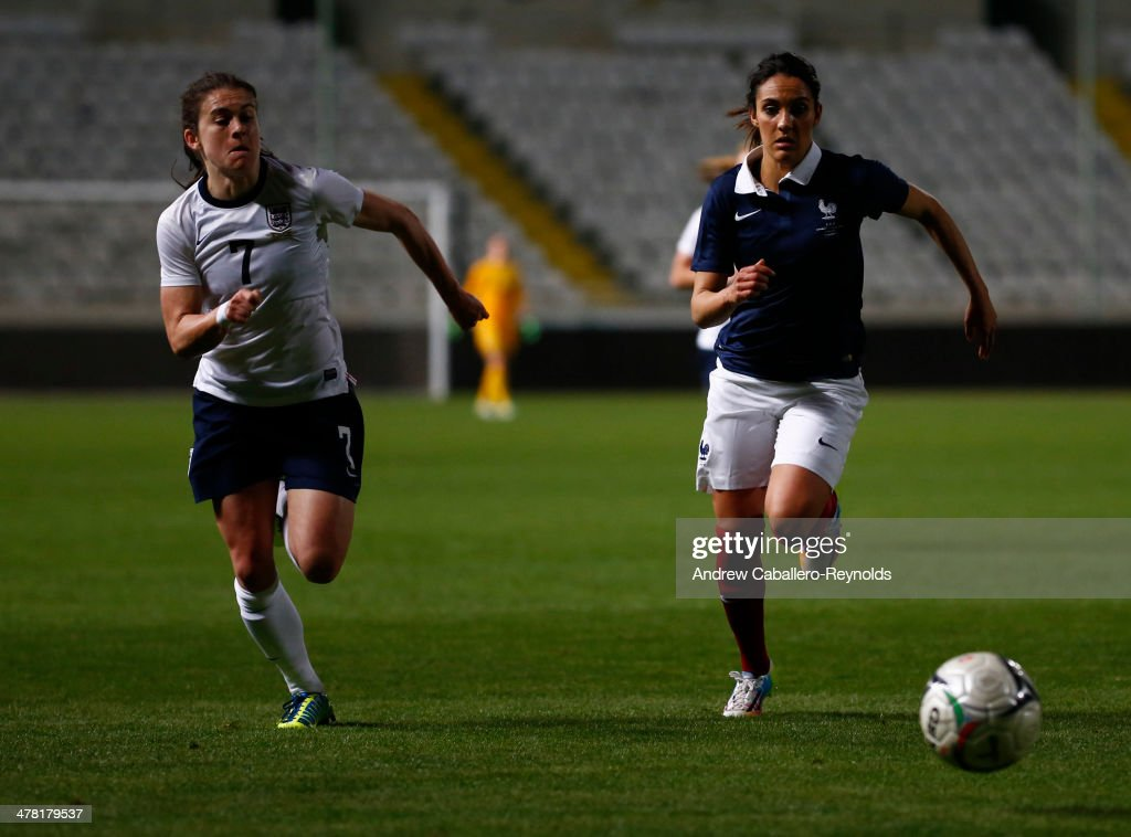Louisa Necib (R)of France and Karen Carney of England in action during the Cyprus cup final between England an France at GSP stadium on March 12, 2014 in Nicosia, Cyprus.