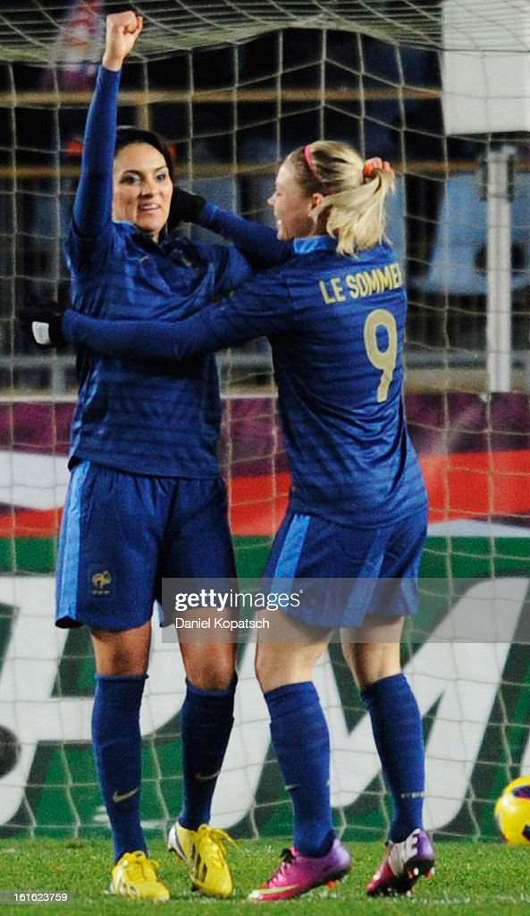 Louisa Necib of France (L) celebrates her team's second goal with team mate Eugenie le Sommer during the international friendly match between France and Germany at Stade de la Meinau on February 13, 2013 in Strasbourg, France.