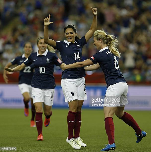 Louisa Necib of France celebrates scoring a goal with Amandine Henry during the FIFA Women's World Cup 2015 quarter final match between Germany and...
