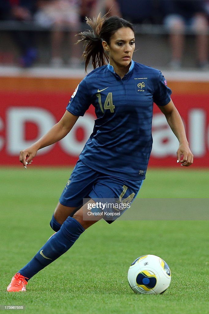 <a gi-track='captionPersonalityLinkClicked' href=/galleries/search?phrase=Louisa+Necib&family=editorial&specificpeople=2333059 ng-click='$event.stopPropagation()'>Louisa Necib</a> of France runs with the ball during the UEFA Women's EURO 2013 Group C match between France and England at Linkoping Arena on July 18, 2013 in Linkoping, Sweden.