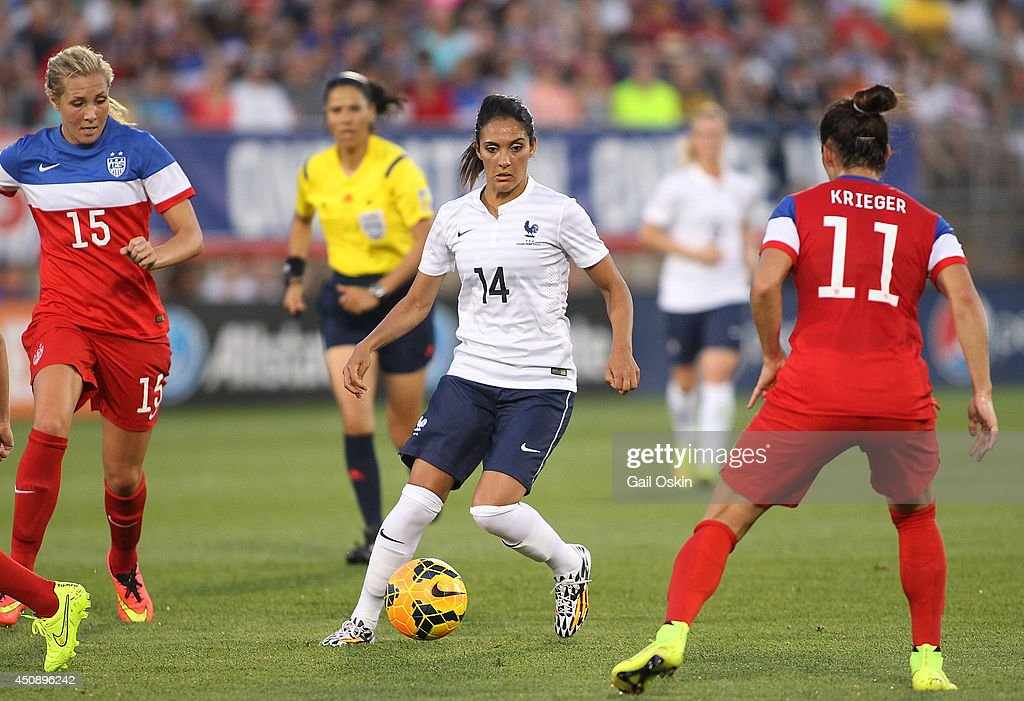 <a gi-track='captionPersonalityLinkClicked' href=/galleries/search?phrase=Louisa+Necib&family=editorial&specificpeople=2333059 ng-click='$event.stopPropagation()'>Louisa Necib</a> #14 of France tries to keep the ball from the United States defense during a game between France and the United States June 19, 2014 at Rentschler Field in East Hartford, Connecticut.