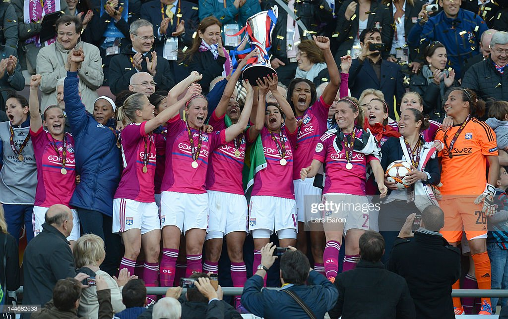 <a gi-track='captionPersonalityLinkClicked' href=/galleries/search?phrase=Louisa+Necib&family=editorial&specificpeople=2333059 ng-click='$event.stopPropagation()'>Louisa Necib</a> of Lyon lifts the trophy and celebrates with team mates after winning the UEFA Women's Champions League Final at Olympiastadion on May 17, 2012 in Munich, Germany.