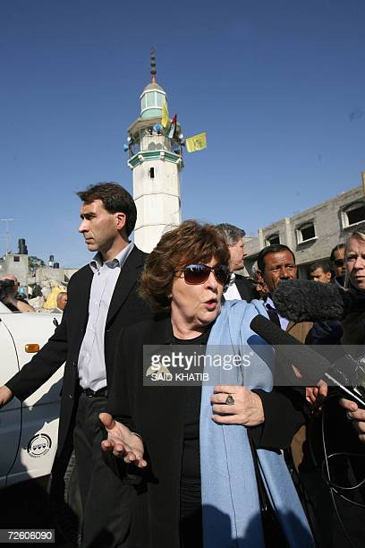 Louise Arbour the UN high commissioner for human rights speaks to the press as she walks past the rubble of a destroyed homes and buildings during...