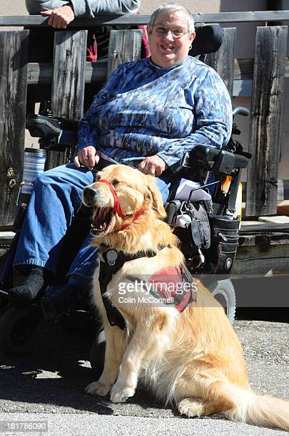 TORONTO ON SEPTEMBER 24 Louise Bark with her service dog Bruce a Golden Retriever She and her dog were denied service at a Pizzaiolo in North York...