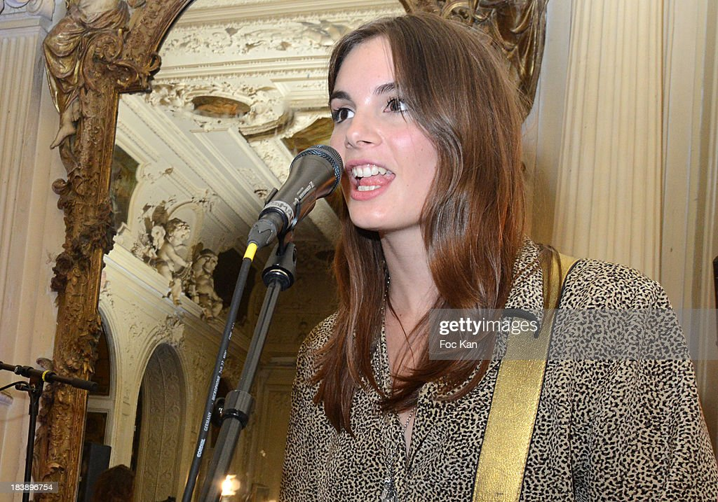 Louise Basilien from The Plastiscines performs during the the Plastiscines private concert hosted by MTV Pulse at The Carmen Club on October 9, 2013 in Paris, France.