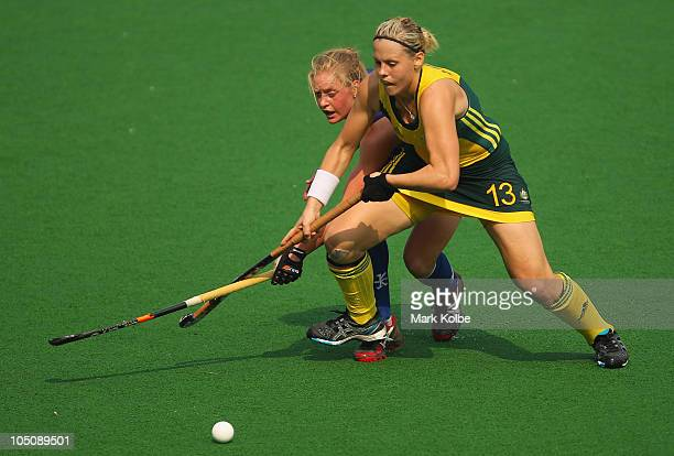 Louise Baxter of Scotland and Shelley Liddelow of Australia compete for the ball during the Women's Pool A match between Australia and Scotland at...