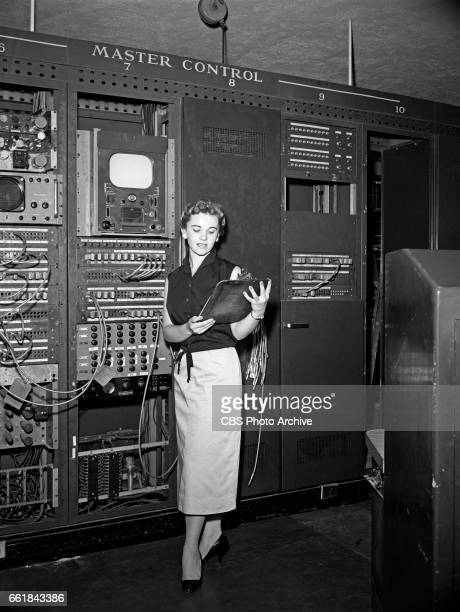 Louise Becker winning contestant of the 'I've Got A Secret' quiz show poses for a photo in the CBS television master control room at 15 Vanderbilt...
