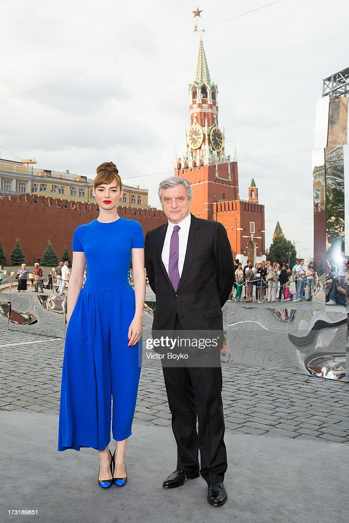 Louise Bourgoin and Sidney Toledano attend the Dior A/W 2013-2014 show at Red Square on July 9, 2013 in Moscow, Russia.