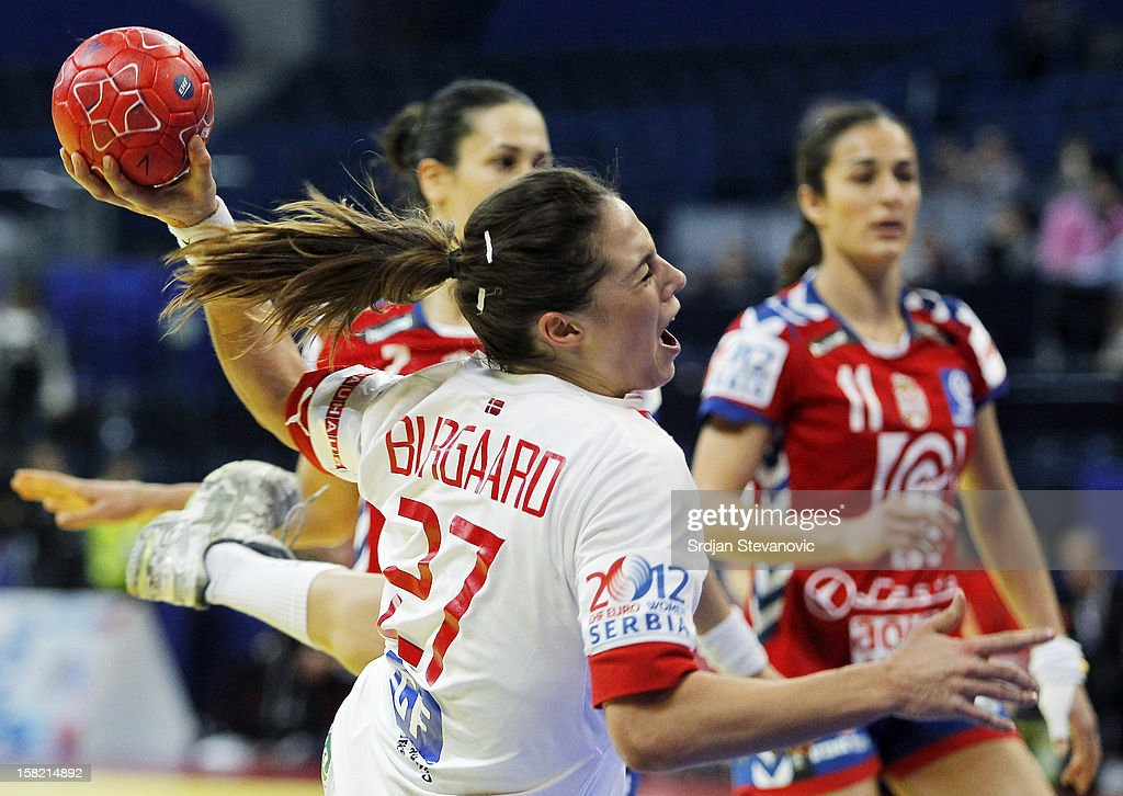 Louise Burgaard (C) of Denmark in action during the Women's European Handball Championship 2012 Group I main round match between Serbia and Denmark at Arena Hall on December 11, 2012 in Belgrade, Serbia.