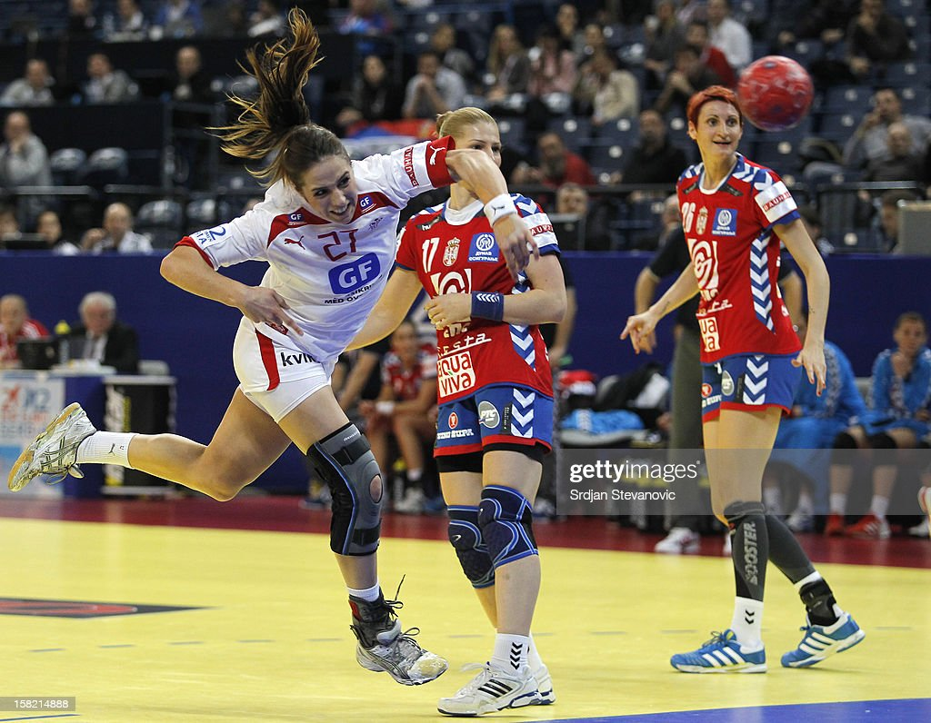 Louise Burgaard (R) of Denmark throws to score near Sanja Rajovic (R) of Serbia during the Women's European Handball Championship 2012 Group I main round match between Serbia and Denmark at Arena Hall on December 11, 2012 in Belgrade, Serbia.