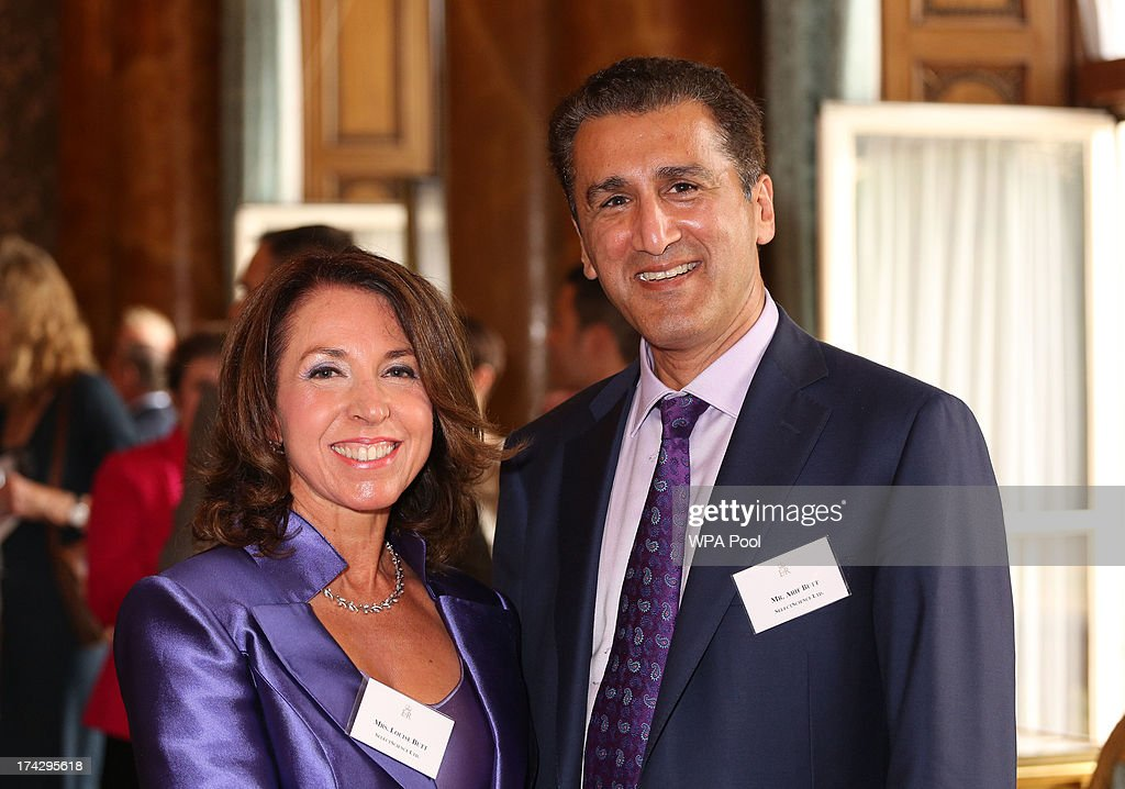 Louise Butt (L) and Arif Butt attend a reception for the Winners of the Queens Award for Enterprise 2013 at Buckingham Palace in London. Tuesday July 23, 2013.