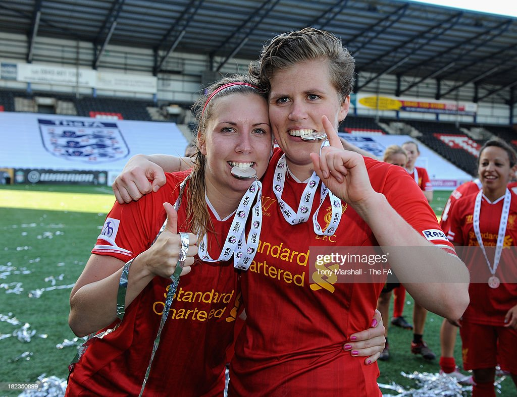 Louise Fors and Katrin Omarsdottir of Liverpool celebrate after winning the FA Women's Super League during the Women's Super League match between Liverpool Ladies FC and Bristol Acadamy Women's FC at Halton Stadium on September 29, 2013 in Widnes, England.