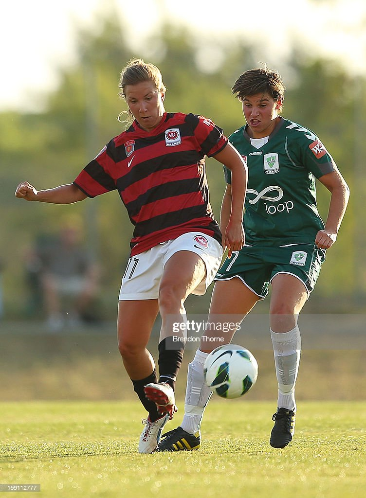 Louise Fors of the Wanderers competes with <a gi-track='captionPersonalityLinkClicked' href=/galleries/search?phrase=Ariane+Hingst&family=editorial&specificpeople=239238 ng-click='$event.stopPropagation()'>Ariane Hingst</a> of Canberra during the round 11 W-League match between Canberra United and the Western Sydney Wanderers at McKellar Park on January 8, 2013 in Canberra, Australia.