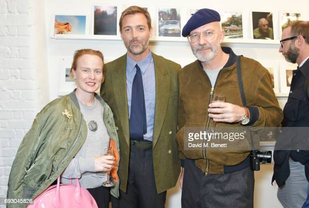 Louise Gray Patrick Grant and Darren Gerrish attend the E Tautz 150 exhibition in aid of Help Refugees on June 6 2017 in London England