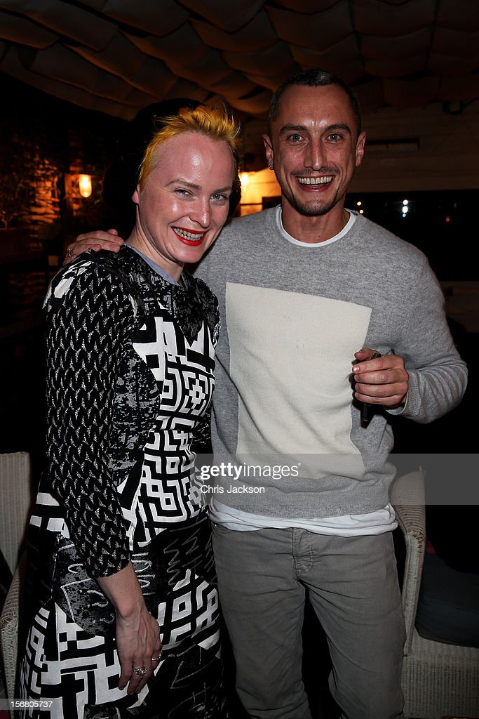 Louise Grey and Richard Nicoll celebrate winning £100 for the Kids Company charity during the Vodafone Fashionable Pub Quiz at Shoreditch House on November 21, 2012 in London, United Kingdom. As Principal Sponsor of London Fashion Week, the quiz celebrated Vodafone's commitment to British Fashion.