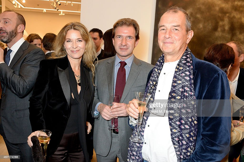 Louise Grob, David Georgiades and David Grob attend the launch party for Phillips European Headquarters at 30 Berkeley Square on October 13, 2014 in London, England.