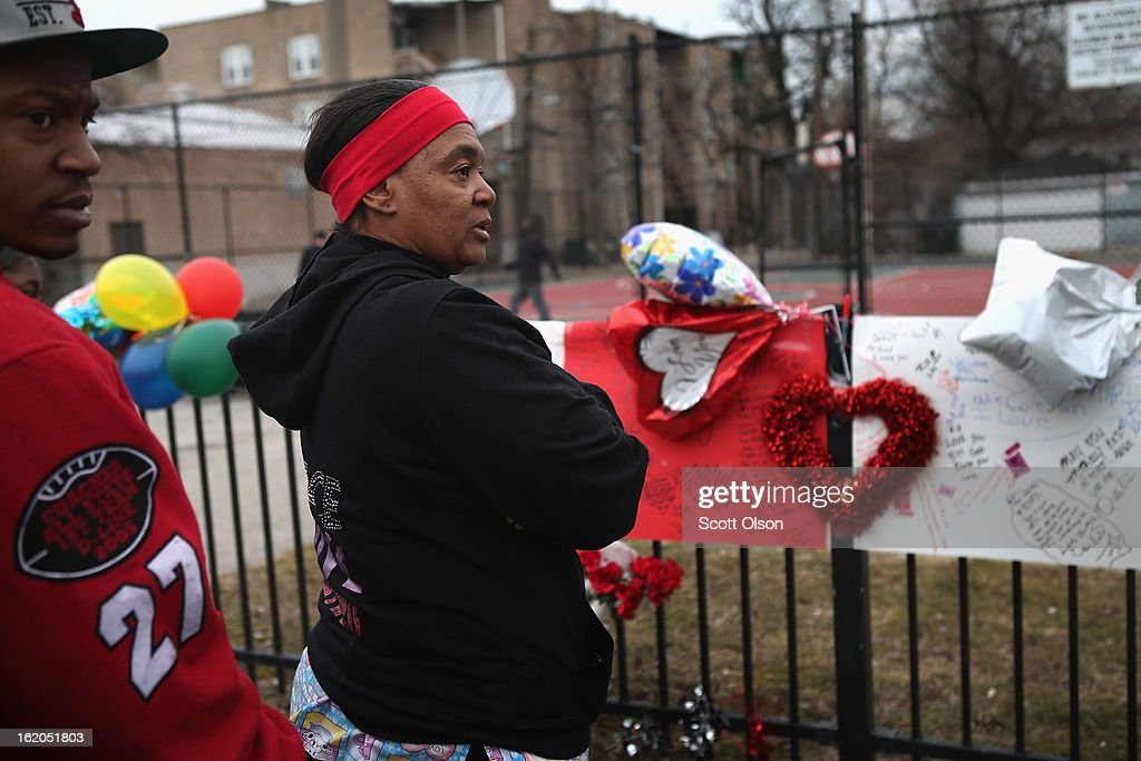 Louise Hardy, with her son Andrew Payton (L), visits a memorial to her eighteen-year-old niece Frances Colon near the spot where she was murdered on February 18, 2013 in Chicago, Illinois. Colon, who was shot February 15th while walking by the neighborhood play lot, was the 51st person murdered in Chicago in 2013. She was the third student from Roberto Clemente High School, a Westside school with less than 800 students, to be murdered in the past three months.