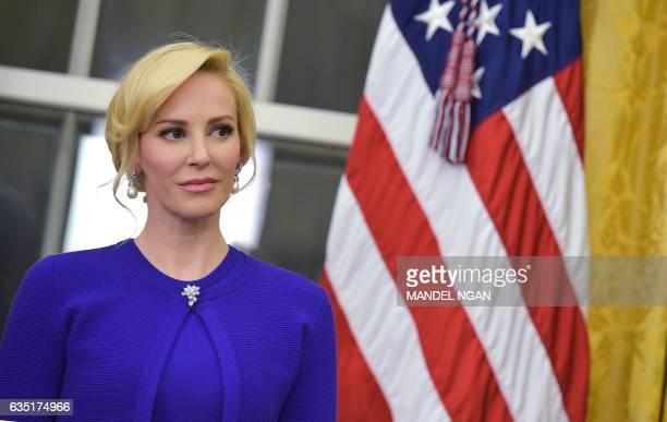 Louise Linton the financee of newly swornin Treasury Secretary Steven Mnuchin watches as speaks after taking the oath of office in the Oval Office of...