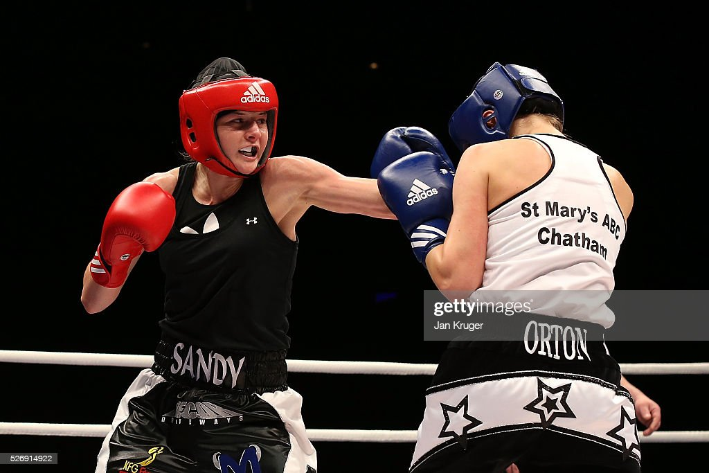 Louise Orton (blue gloves) in action against Sandy Ryan in their over 60kg final bout during day three of the Boxing Elite National Championships at Echo Arena on May 01, 2016 in Liverpool, England.