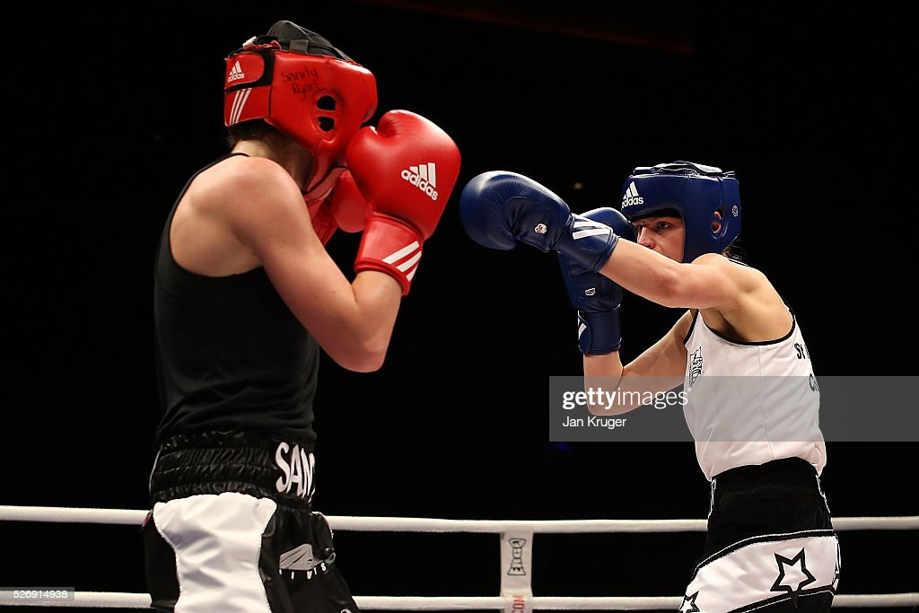 Louise Orton(blue gloves) in action against Sandy Ryan in their over 60kg final bout during day three of the Boxing Elite National Championships at Echo Arena on May 01, 2016 in Liverpool, England.