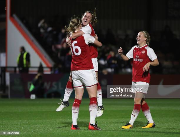 Louise Quinn of Arsenal celebrates with teammates after scoring her side's seventh goal during the FA WSL Continental Cup match between Arsenal and...
