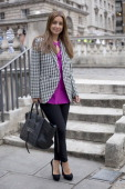 Louise Redknapp wearing Christian Louboutin shoes and Celine Phantom bag and a houndstooth jacket at London Fashion week autumn/winter 2012...
