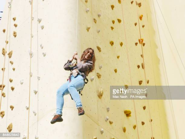 Louise Thompson from 'Made in Chelsea' hanging from the 22m high Walkers Deep Ridged Crisp wall at launch of the new Walkers Deep Ridged crisps at...