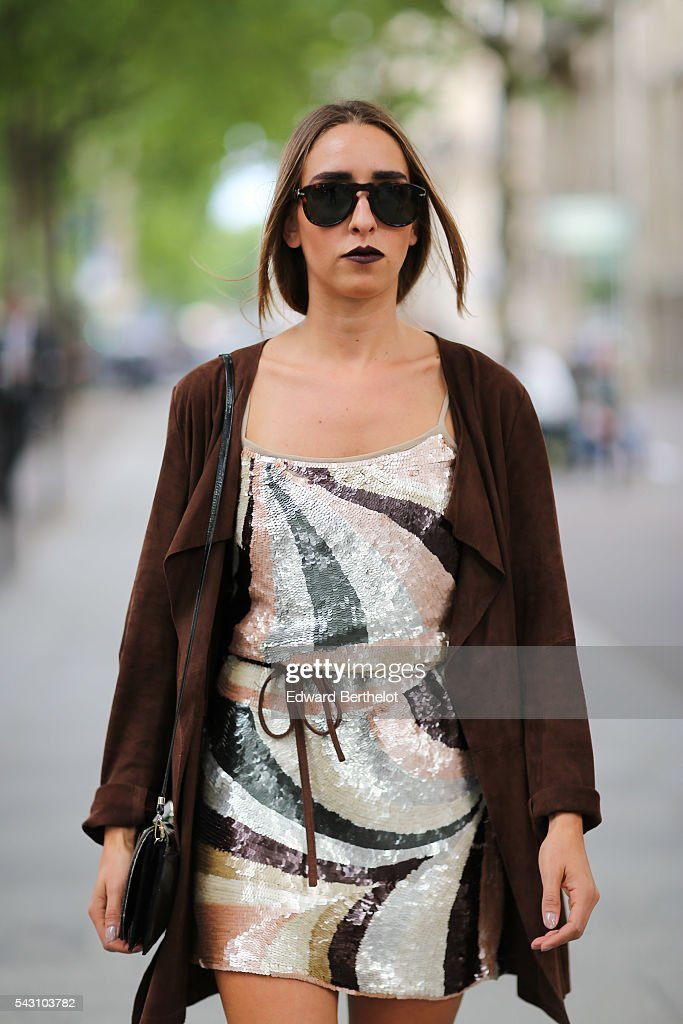 Louise-Clemence Lavergne is wearing a Sinequanone skirt, and Superga shoes, before the Balmain show, during Paris Fashion Week Menswear Spring/summer 2017, on June 25, 2016 in Paris, France.