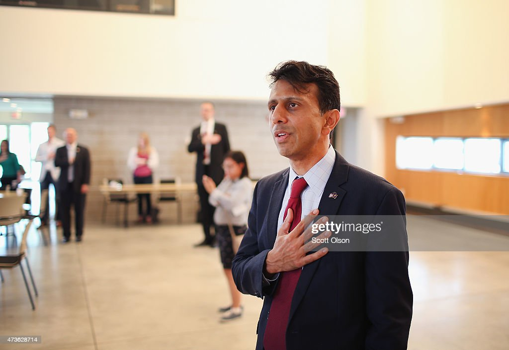 Louisiana Gov. <a gi-track='captionPersonalityLinkClicked' href=/galleries/search?phrase=Bobby+Jindal&family=editorial&specificpeople=2249969 ng-click='$event.stopPropagation()'>Bobby Jindal</a> recites the Pledge of Allegiance at the Story County GOP breakfast at Oakwood Church May 16, 2015 in Ames, Iowa. Jindal and several other Republican presidential hopefuls are attending events in the state this weekend. Hillary Clinton, who hopes to become the Democrat's choice, is expected in Iowa for events on Monday and Tuesday.