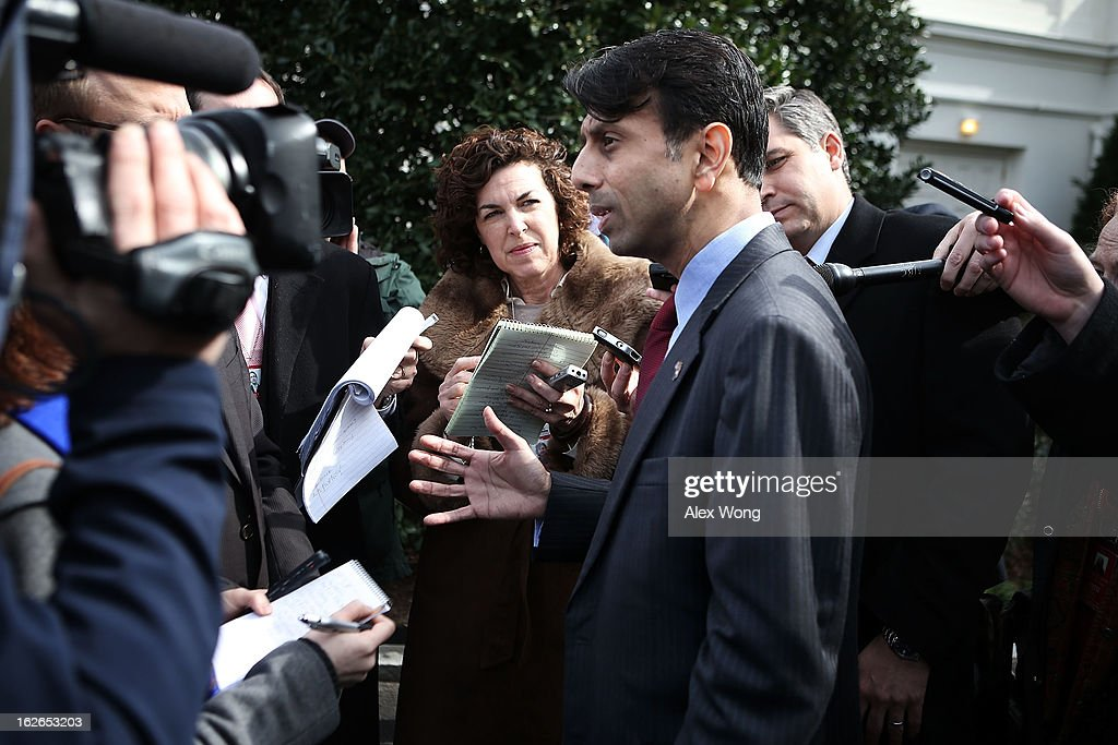 Louisiana Gov. <a gi-track='captionPersonalityLinkClicked' href=/galleries/search?phrase=Bobby+Jindal&family=editorial&specificpeople=2249969 ng-click='$event.stopPropagation()'>Bobby Jindal</a> (2nd R) speaks to members of the press after a State Dining Room meeting with U.S. President Barack Obama at the White House February 25, 2013 in Washington, DC. Governors from across the nation were in Washington for the 2013 National Governors Association Winter Meeting.